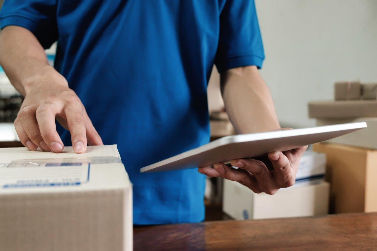 courier using tablet to checking the delivery receipt list in